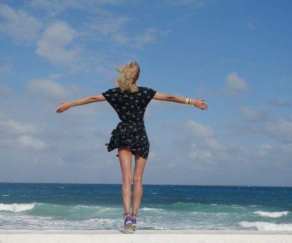 vj video background Girl-travel-raises-her-arms-and-hands-up-in-slow-motion-on-the-sea-ocean-beach_003