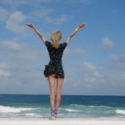 Girl-travel-raises-her-arms-and-hands-up-in-slow-motion-on-the-sea-ocean-beach_005 National Footage
