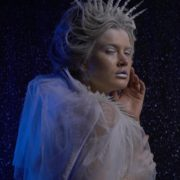 Ice-Queen-isolated-blonde-girl-over-black-background-with-glow-snow-and-blue-effect_006 National Footage