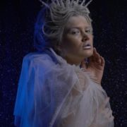 Ice-Queen-isolated-blonde-girl-over-black-background-with-glow-snow-and-blue-effect_007 National Footage