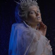 Ice-Queen-isolated-blonde-girl-over-black-background-with-glow-snow-and-blue-effect_008 National Footage