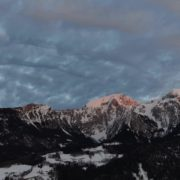 vj video background Rapid-flow-of-clouds-in-the-mountains-snow-capped-from-the-height-of-the-birds-flight-drones_003
