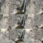 Rocky-mountains-from-which-flows-a-small-waterfall-of-crystal-clear-water National Footage