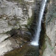 Rocky-mountains-from-which-flows-a-small-waterfall-of-crystal-clear-water_001 National Footage