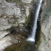 Rocky-mountains-from-which-flows-a-small-waterfall-of-crystal-clear-water_002 National Footage