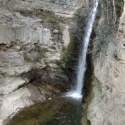 Rocky-mountains-from-which-flows-a-small-waterfall-of-crystal-clear-water_004 National Footage