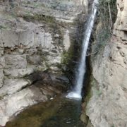 Rocky-mountains-from-which-flows-a-small-waterfall-of-crystal-clear-water_005 National Footage