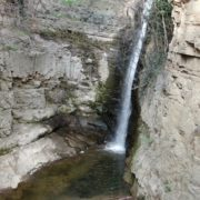 Rocky-mountains-from-which-flows-a-small-waterfall-of-crystal-clear-water_006 National Footage
