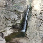Rocky-mountains-from-which-flows-a-small-waterfall-of-crystal-clear-water_009 National Footage