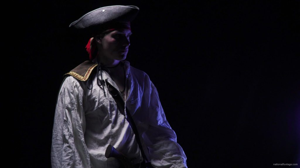 Sea-Wolf-Capitain-of-Pirate-Ship-exploring-in-the-night-isolated-on-black_001 National Footage