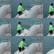 Sea-man-makes-nodes-on-yacht-catamaran-in-slow-motion National Footage