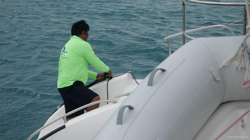 Sea-man-makes-nodes-on-yacht-catamaran-in-slow-motion_001 National Footage