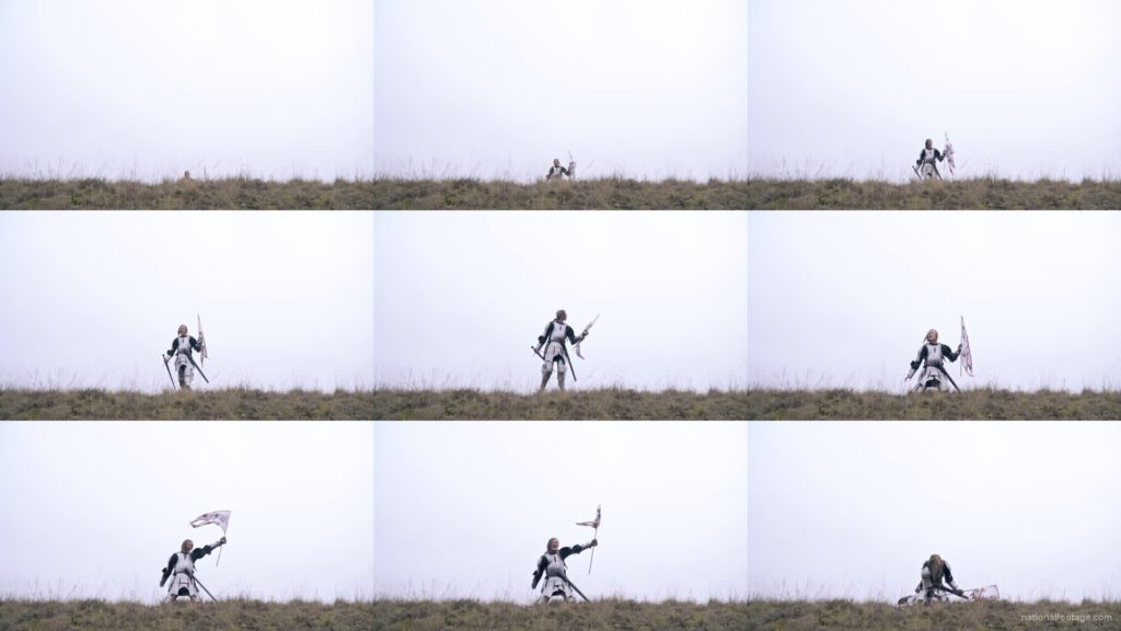 Strong-blonde-girl-knight-with-armor-sword-and-flag-calling National Footage