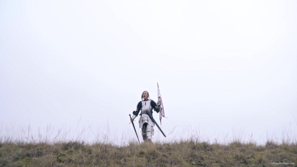 Strong-blonde-girl-knight-with-armor-sword-and-flag-calling_004 National Footage