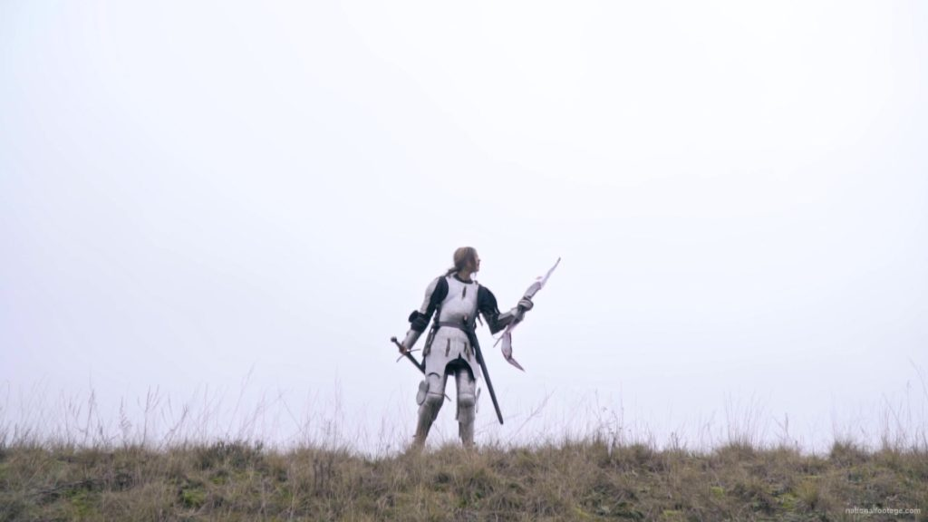 Strong-blonde-girl-knight-with-armor-sword-and-flag-calling_005 National Footage