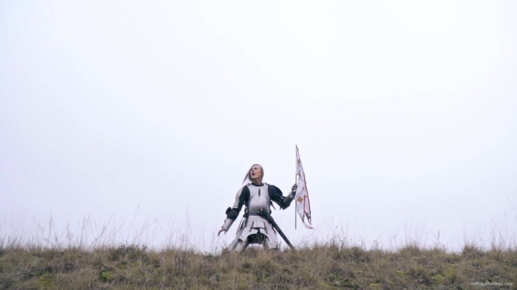 Strong-blonde-girl-knight-with-armor-sword-and-flag-calling_006 National Footage