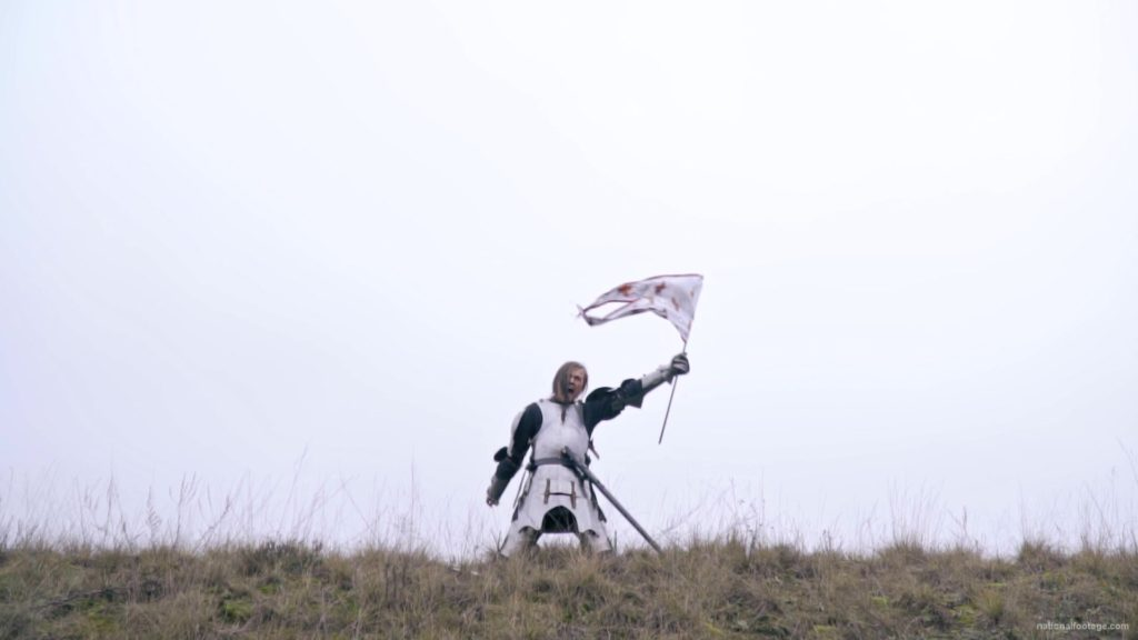 Strong-blonde-girl-knight-with-armor-sword-and-flag-calling_007 National Footage