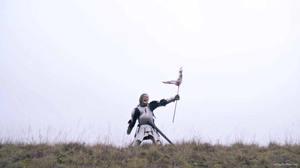 Strong-blonde-girl-knight-with-armor-sword-and-flag-calling_008 National Footage