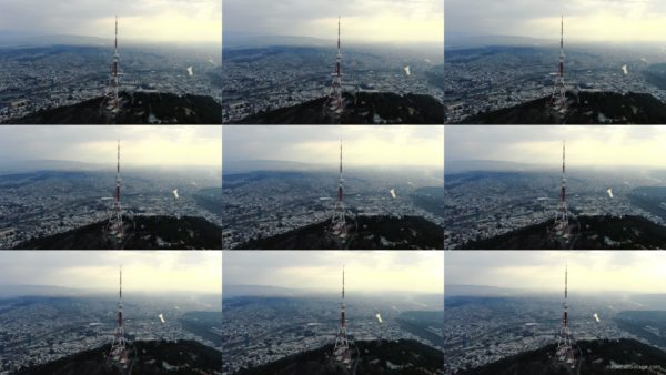 Viewing-mobile-TV-tower-from-the-birds-eye-view-above-the-big-city National Footage