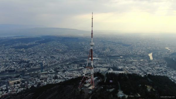 Viewing-mobile-TV-tower-from-the-birds-eye-view-above-the-big-city_001 National Footage