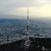 Viewing-mobile-TV-tower-from-the-birds-eye-view-above-the-big-city_002 National Footage