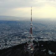 Viewing-mobile-TV-tower-from-the-birds-eye-view-above-the-big-city_004 National Footage