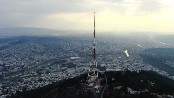 Viewing-mobile-TV-tower-from-the-birds-eye-view-above-the-big-city_007 National Footage
