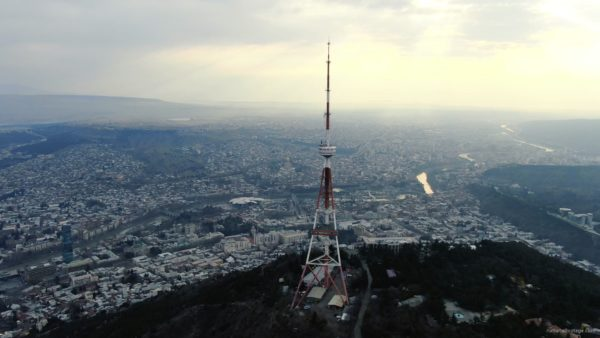 Viewing-mobile-TV-tower-from-the-birds-eye-view-above-the-big-city_008 National Footage