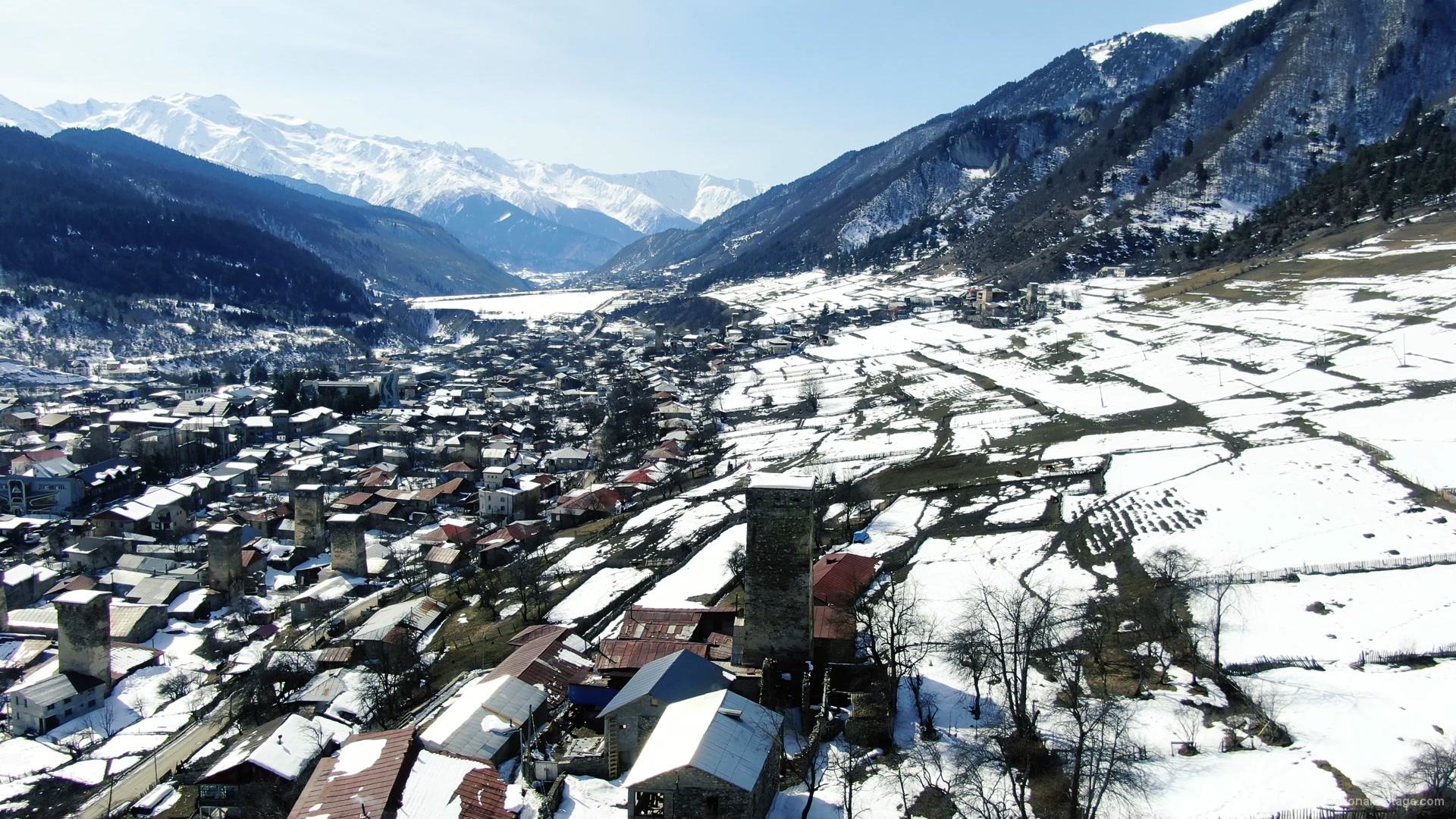 vj video background Winter-town-in-the-snowy-mountains-with-beautiful-views-and-ancient-towers_003