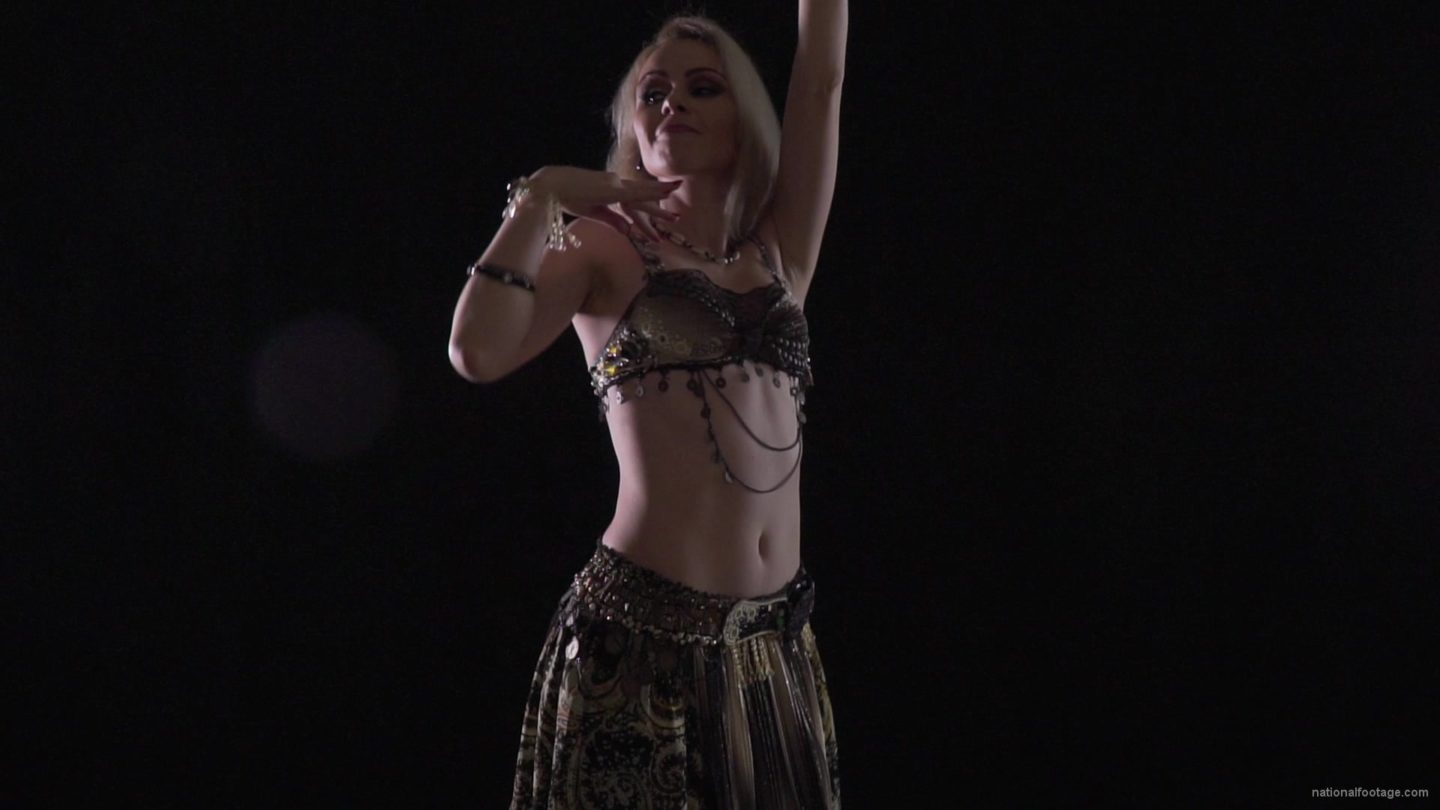 vj video background Woman-dancing-belly-dance-in-a-golden-suit-on-a-black-background_003