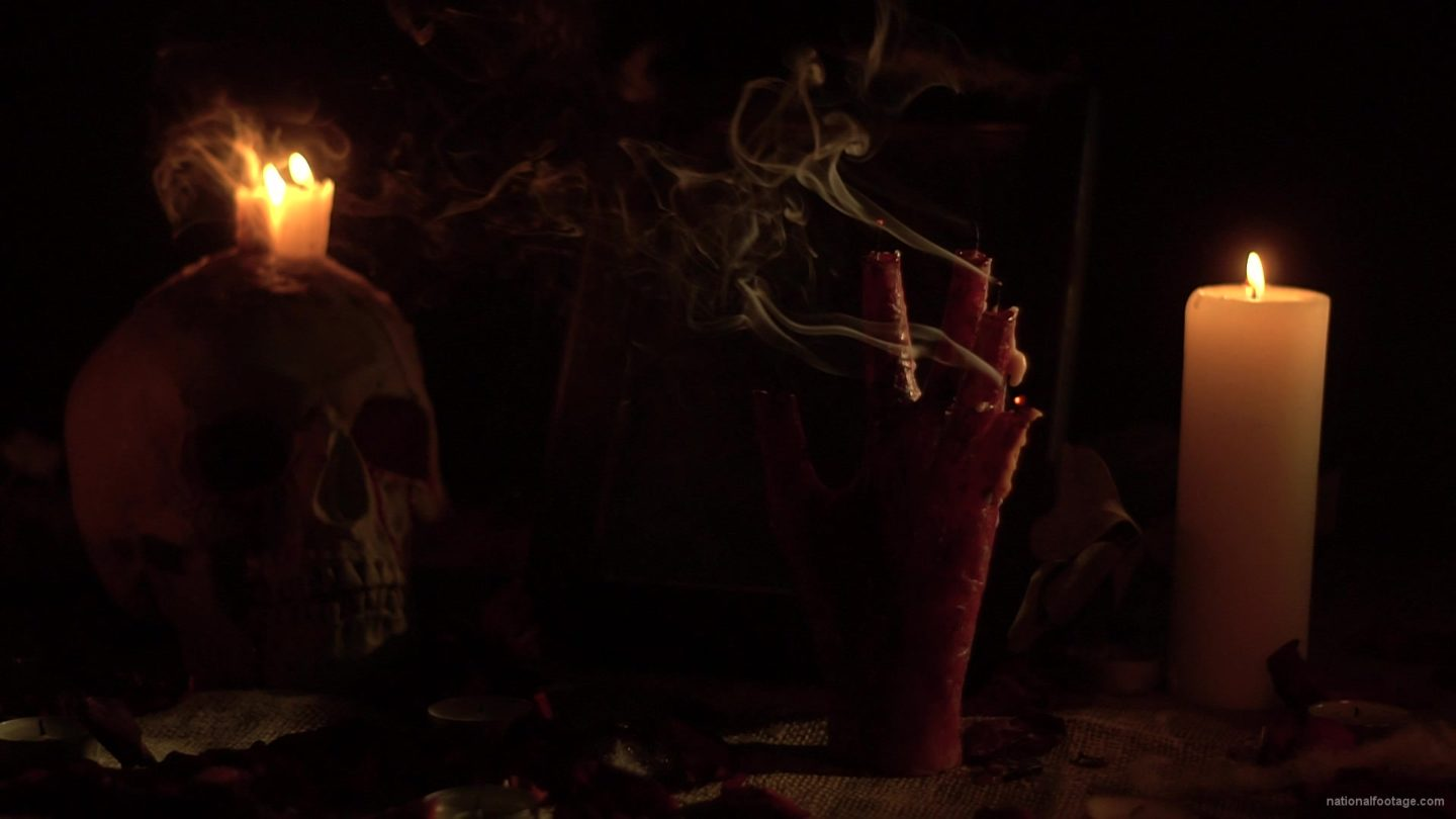 vj video background skull-with-a-candle-and-a-hand-in-the-form-of-a-candle-from-the-quench-of-the-wind_003
